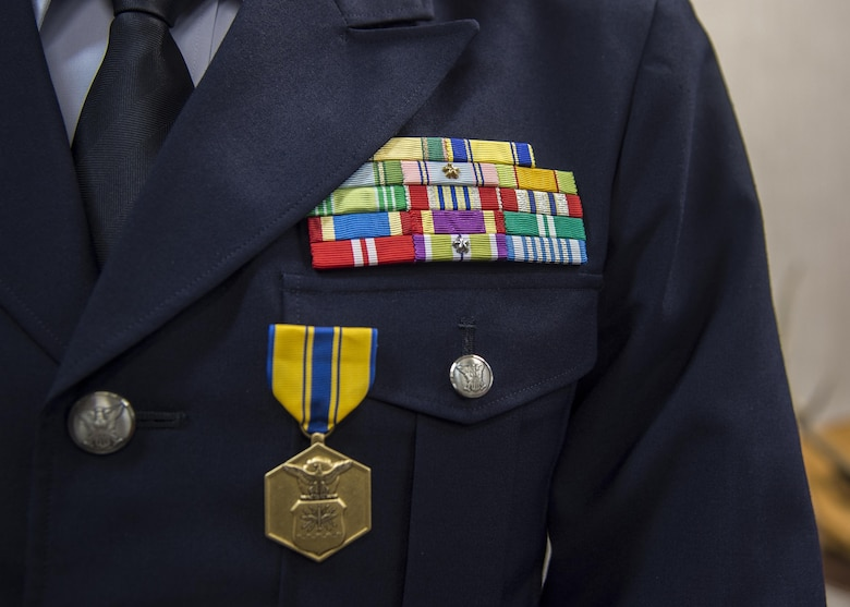 The U.S. Air Force Commendation Medal rests on the chest of Japan Air Self-Defense Force Col. Shunichi Araki, the Northern Aircraft Control and Warning Wing vice commander, after it was presented at Misawa Air Base, Japan, July 27, 2017. Araki received this medal for his actions during his tenure at Yokota Air Base, Japan, as Operations Support Wing, Air Defense Command vice commander. His accomplishments included being a key asset during the Yokota Friendship Festival, exercise KEEN EDGE and enhancing bilateral partnerships among the U.S. and Japan. (U.S. Air Force photo by Staff Sgt. Deana Heitzman)