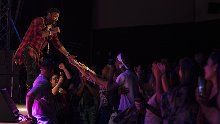 "Orville Burrell, better known as ""Shaggy,"" a musical artist and Marine Corps veteran, interacts with his fans during a live concert at Marine Corps Air Station Iwakuni, Japan, July 26, 2017. Shaggy sang a variety of his hit songs including ""Boombastic,"" ""It Wasn't Me"" and ""Oh Carolina."" The concert was part of an Armed Forces Entertainment tour that included three military installations across Japan. (U.S. Marine Corps photo by Cpl. Donato Maffin)"