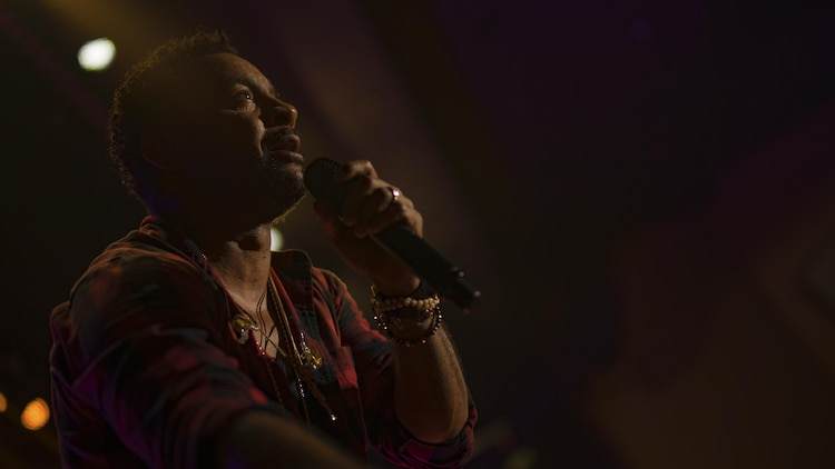 """Orville Burrell, better known as """"Shaggy,"""" a musical artist and Marine Corps veteran, sings out to his fans during a live concert at Marine Corps Air Station Iwakuni, Japan, July 26, 2017. Shaggy sang a variety of his hit songs including """"Boombastic,"""" """"It Wasn't Me"""" and """"Oh Carolina."""" The concert was part of an Armed Forces Entertainment tour that included three military installations across Japan. (U.S. Marine Corps photo by Cpl. Donato Maffin)"""