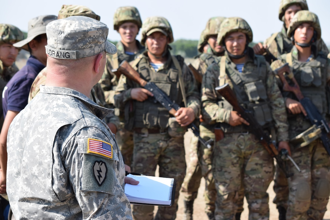 Capt. Kenneth Lorang, Training and Doctrine Command liaison officer to U.S. Army Central, takes notes during an after action review of a simulation lane July 26, 2017, during Exercise Steppe Eagle 17 at Illisky Training Center near Almaty, Kazakhstan.