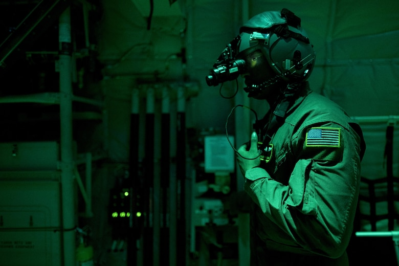 Airman 1st Class Young Achuka, a 36th Airlift Squadron C-130J Super Hercules loadmaster, communicates with aircrew during cargo drop training, July 18, 2017, at Yokota Air Base, Japan. Regular night time training operations are essential and ensure 24-hour mission readiness. (U.S. Air Force photo/Airman 1st Class Donald Hudson)