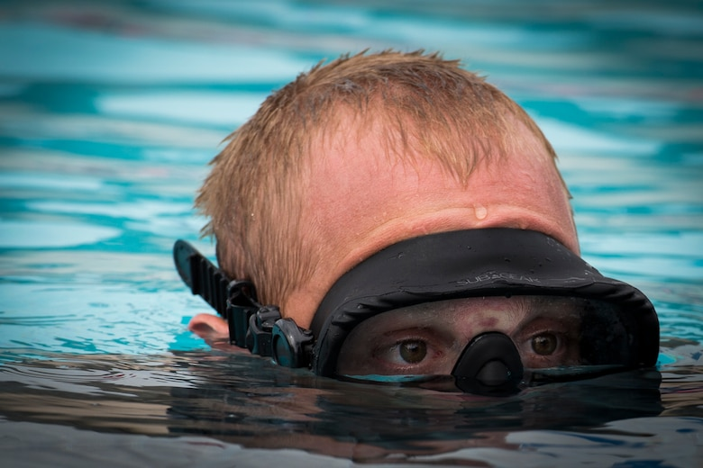 Senior Airman Heath Jolley, a survival, evasion, resistance and escape specialist with the 1st Special Operations Support Squadron, supervises rotary wing water survival training from at Hurlburt Field, Fla., July 18, 2017. Three SERE specialists supervised more than 10 aircrew members performing emergency exit procedures, while submerged, to ensure the aircrew is proficient if ever faced with a real-world incident. (U.S. Air Force photo/Airman 1st Class Joseph Pick)