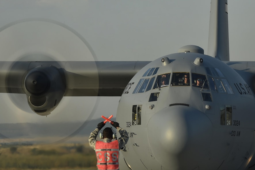 Staff Sgt. Nestor Fraga, a 321st Contingency Response Squadron aircraft maintainer, marshals a C-130 Hercules aircraft during Exercise Saber Guardian 17 at Bezmer Air Base, Bulgaria, July 19, 2017. The largest of the Black Sea region exercises, SG17 highlights participant deterrence capabilities, specifically the ability to mass forces at any given time anywhere in Europe to support the security and stability of the Black Sea region. (U.S. Air Force Photo/Tech. Sgt. Liliana Moreno)
