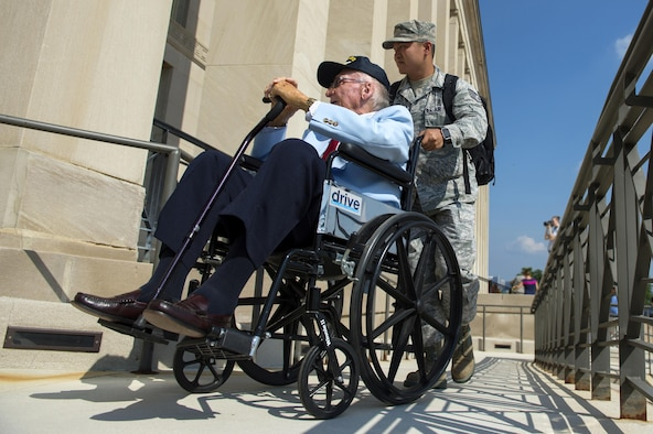 Staff Sgt. Frederick Taguba assists USS Arizona survivor Navy Seaman First Class Donald Stratton enter the Pentagon in Arlington, Va., July 17, 2017. Three survivors of the USS Arizona, which was attacked at Pearl Harbor at the beginning of World War II, toured the Pentagon. (Department of Defense photo/EJ Hersom)