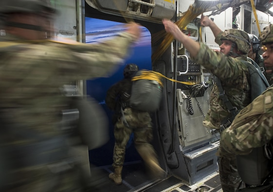 Soldiers of the 82nd Airborne Division conduct a static line jump out of a C-17 Globemaster III during exercise Panther Storm at Fort Bragg, N.C., July 24, 2017. The deployment readiness exercise tests the division's ability to rapidly deploy its global response force anywhere in the world within a short notice. (U.S. Air Force photo/Staff Sgt. Andrew Lee)