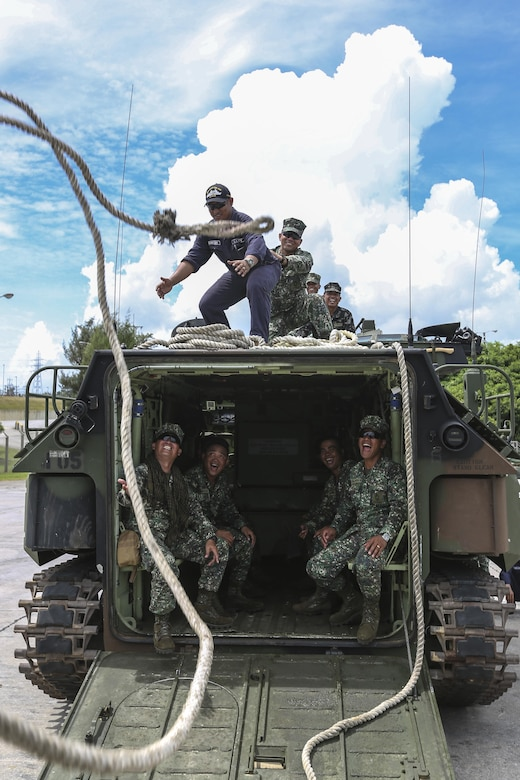 Philippine Marines with Assault Armor Battalion practice tossing a rope from one amphibious assault vehicle to another during egress training at Camp Schwab, Okinawa, Japan, July 18, 2017. This was the first time the Philippine military conducted training at an American base. The Philippine Marine Corps recently purchased AAVS and were working with U.S. Marines to learn different amphibious procedures -- such as hand signaling, egress training and water operations. Marine Corps photo by Lance Cpl. Jordan A. Talley