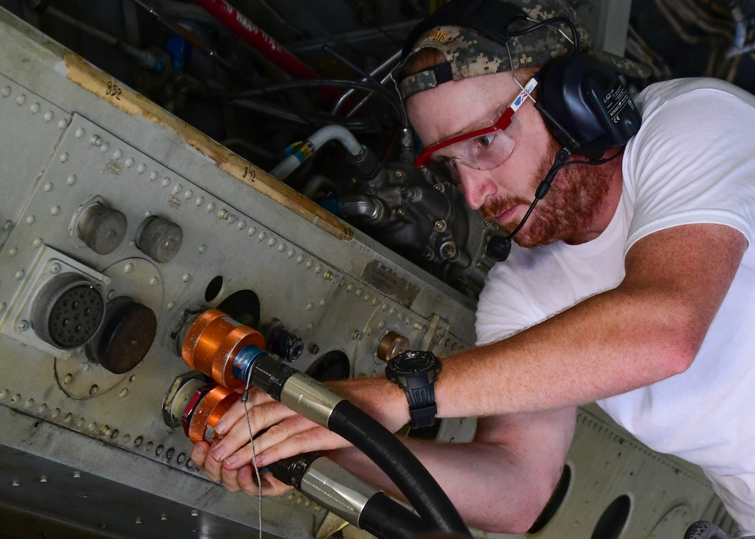 Staff Sgt. Brian Vermillion, assigned to the 307th Maintenance Squadron, attaches hydraulic tester to the hydraulic system inside the bomb bay of a B-52 Stratofortress during a phase inspection on Barksdale Air Force Base, La. June 28, 2017. The testing of the hydraulic system is part of the phase inspection of the B-52 that must be performed every 450 flight hours. (U.S. Air Force photo by Master Sgt. Dachelle Melville/Released)