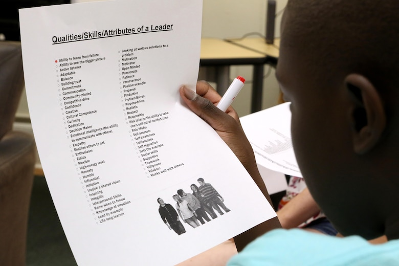 Trevor, 13, reads over a leader qualities checklist during a Stand Out Leaders in Training teen leadership day aboard Marine Corps Air Station Cherry Point, N.C., July 25, 2017. The day started with a guided discussion titled Leadership 101 to identify what traits the students have and can build upon. Trevor is a high school student in Craven County. (U.S. Marine Corps photo by Cpl. Jason Jimenez/ Released)