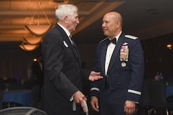 Richard McCormick, World War II veteran, speaks to Lt. Gen. Giovanni Tuck, 18th Air Force commander, at the 457th Airlift Squadron's 75th anniversary banquet at Joint Base Andrews, Md., June 30, 2017. McCormick was a central fire control operator with the 457th Bombardment Squadron stationed in the Pacific during WWII.  (U.S. Air Force photo by Airman 1st Class Rustie Kramer)