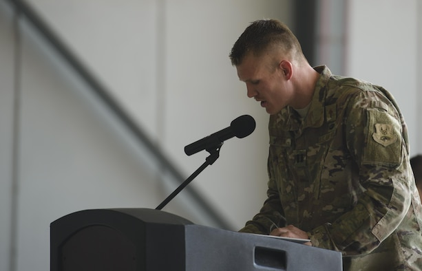 Chaplain (Capt.) Joshua Flynn, 455th Air Expeditionary Wing, delivers an invocation during a ceremony at Bagram Airfield, Afghanistan, July 14, 2017. Religious support teams from the 455th AEW travel throughout Afghanistan to accommodate the spiritual needs of service members and coalition forces. (U.S. Air Force photo by Staff Sgt. Benjamin Gonsier)