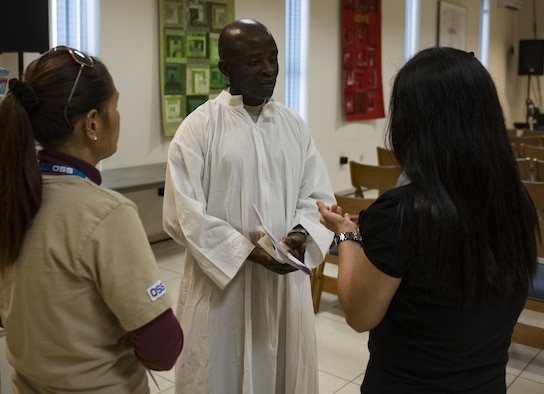 Chaplain (Capt.) John Appiah, 455th Air Expeditionary Wing, interacts with churchgoers at Hamid Karzai International Airport, Kabul, Afghanistan, July 23, 2017. Religious support teams from the 455th AEW provide spiritual support in seven locations in Afghanistan. (U.S. Air Force photo by Staff Sgt. Benjamin Gonsier)
