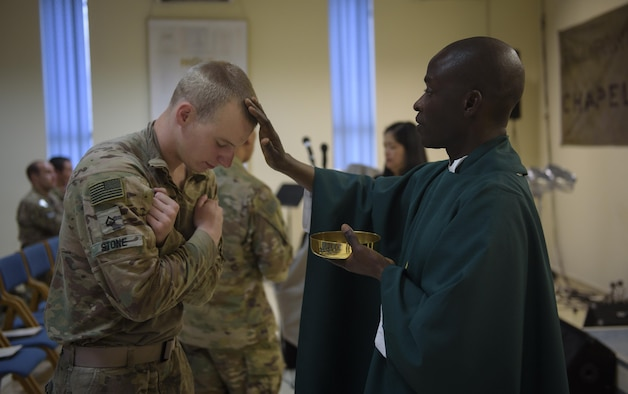 Chaplain (Capt.) John Appiah, 455th Air Expeditionary Wing, blesses a U.S. Army Soldier during a religious service at Hamid Karzai International Airport, Kabul, Afghanistan, July 23, 2017. Religious support teams from Bagram Airfield visit six different locations in Afghanistan where a chaplain is not deployed. (U.S. Air Force photo by Staff Sgt. Benjamin Gonsier)