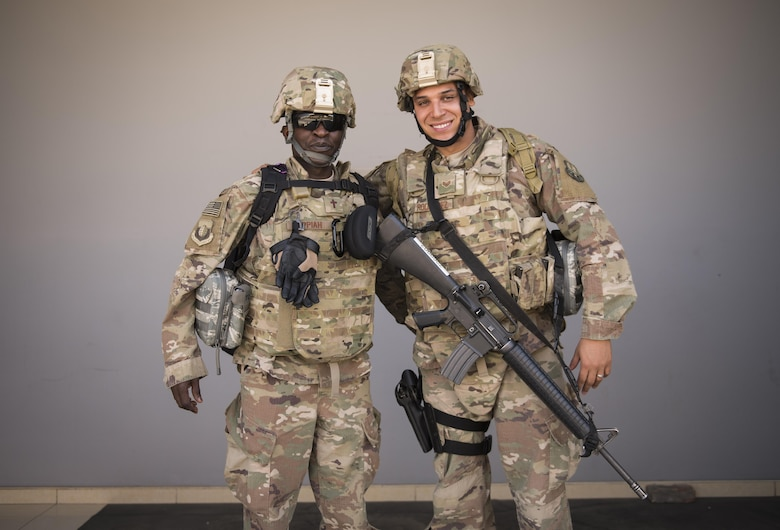 Chaplain (Capt.) John Appiah and Staff Sgt. Christopher Rodriguez, 455th Air Expeditionary Wing, prepare to leave Hamid Karzai International Airport, Kabul, July 23, 2017. Since chaplains are noncombatants, their assistants, though not trained bodyguards, take on the extra responsibility of defending their chaplain if in a hostile situation. (U.S. Air Force photo by Staff Sgt. Benjamin Gonsier)