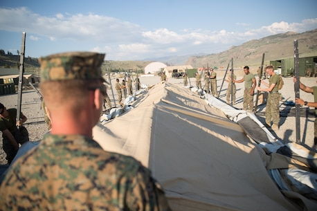 U.S. Marines with Combat Logistics Battalion 5 (CLB-5), Combat Logistics Regiment 1, 1st Marine Logistics Group, help form the foundation of an expeditionary mess hall on the Marine Corps Mountain Warfare Training Center Bridgeport, Calif., June 14, 2017. CLB-5 supports the 2d Battalion, 8th Marine Regiment, 2d Marine Division, logistically by tackling the technical aspects of mountainous and cold weather operations by providing them chow, water, and fuel. (U.S. Marine Corps photo by Lance Cpl. Timothy Shoemaker)