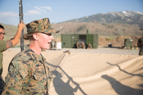 U.S. Marine Pfc. Olivia Rutherford, an ammunition technician with Combat Logistics Battalion 5 (CLB-5), Combat Logistics Regiment 1, 1st Marine Logistics Group, gives an order to her fellow Marines during the construction of an expeditionary mess hall at Marine Corps Mountain Warfare Training Center Bridgeport, Calif., June 14, 2017. CLB-5 supports the 2d Battalion, 8th Marine Regiment, 2d Marine Division, logistically by tackling the technical aspects of mountainous and cold weather operations by providing them chow, water, and fuel. (U.S. Marine Corps photo by Lance Cpl. Timothy Shoemaker)