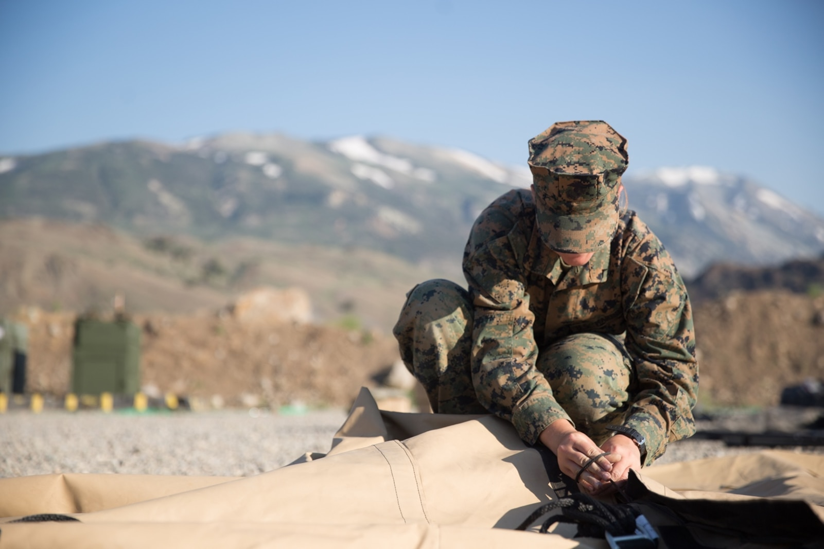 U.S. Marine Pfc.Olivia Rutherford, an ammunition technician with Combat Logistics Battalion 5 (CLB-5), Combat Logistics Regiment 1, 1st Marine Logistics Group, helps tie a knot on an expeditionary mess hall during a Mountain Exercise 4-17 on the Marine Corps Mountain Warfare Training Center Bridgeport, Calif., June 14, 2017. CLB-5 supports the 2d Battalion, 8th Marine Regiment, 2d Marine Division, logistically by tackling the technical aspects of mountainous and cold weather operations by providing them chow, water, and fuel. (U.S. Marine Corps photo by Lance Cpl. Timothy Shoemaker)