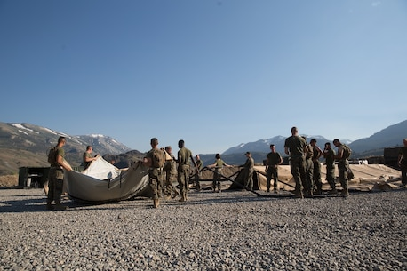 U.S. Marines with Combat Logistics Battalion 5 (CLB-5), Combat Logistics Regiment 1, 1st Marine Logistics Group, begin the construction of an expeditionary mess hall on the Marine Corps Mountain Warfare Training Center Bridgeport, Calif., June 14, 2017. CLB-5 supports the 2d Battalion, 8th Marine Regiment, 2d Marine Division, logistically by tackling the technical aspects of mountainous and cold weather operations by providing them chow, water, and fuel. (U.S. Marine Corps photo by Lance Cpl. Timothy Shoemaker)