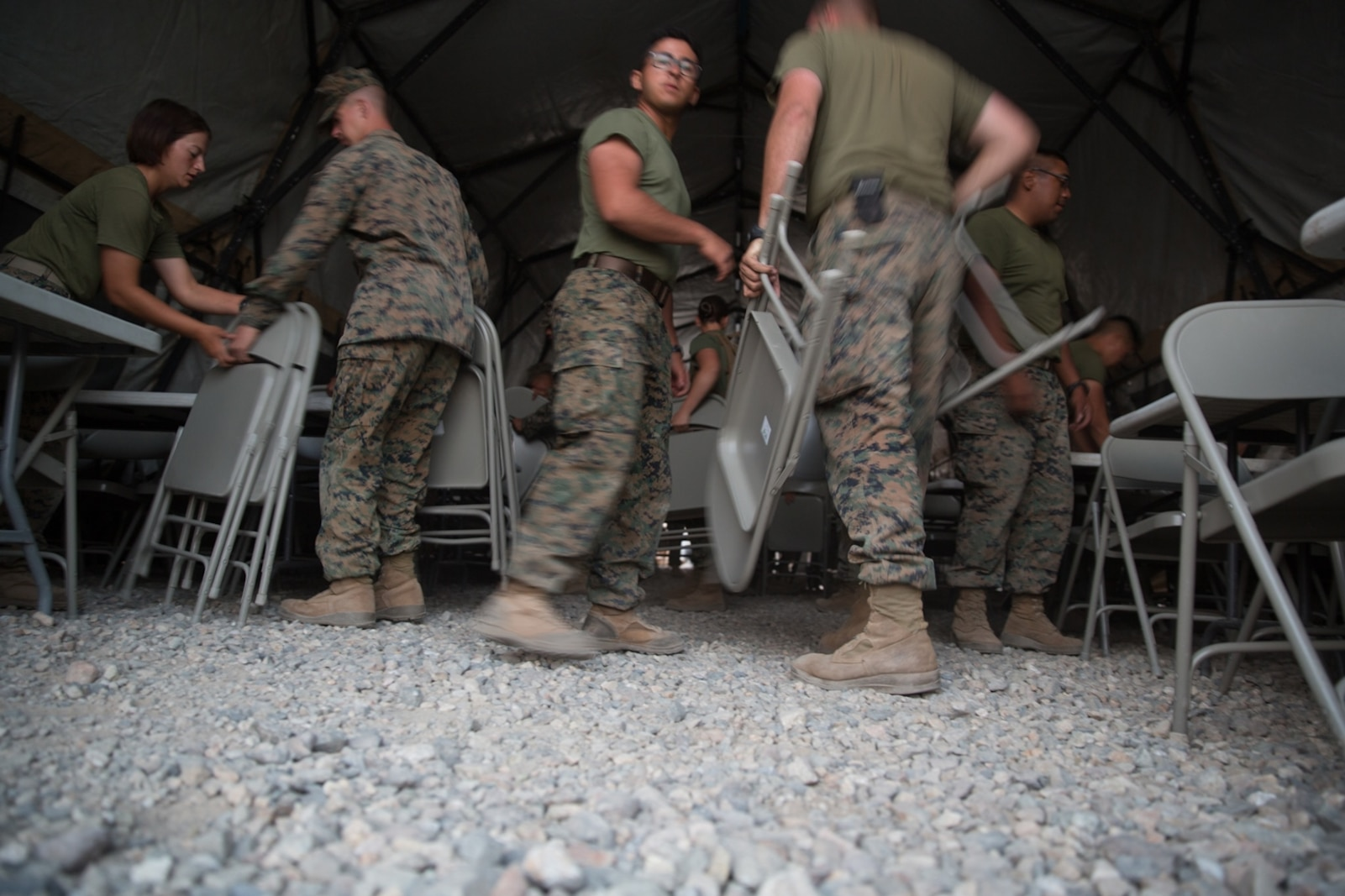 U.S. Marines with Combat Logistics Battalion 5 (CLB-5), Combat Logistics Regiment 1, 1st Marine Logistics Group, place chairs inside an expeditionary mess hall on the Marine Corps Mountain Warfare Training Center Bridgeport, Calif., June 14, 2017. CLB-5 supports the 2d Battalion, 8th Marine Regiment, 2d Marine Division, logistically by tackling the technical aspects of mountainous and cold weather operations by providing them chow, water, and fuel. (U.S. Marine Corps photo by Lance Cpl. Timothy Shoemaker)