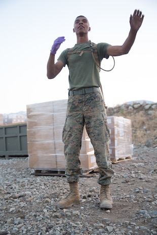 U.S. Marine Cpl. Shawn Pettway, a landing support specialist with Combat Logistics Battalion 5 (CLB-5), Combat Logistics Regiment 1, 1st Marine Logistics Group, directs his Marines to move a tent on the Marine Corps Mountain Warfare Training Center Bridgeport, Calif., June 14, 2017. CLB-5 supports the 2d Battalion, 8th Marine Regiment, 2d Marine Division, logistically by tackling the technical aspects of mountainous and cold weather operations by providing them chow, water, and fuel. (U.S. Marine Corps photo by Lance Cpl. Timothy Shoemaker)