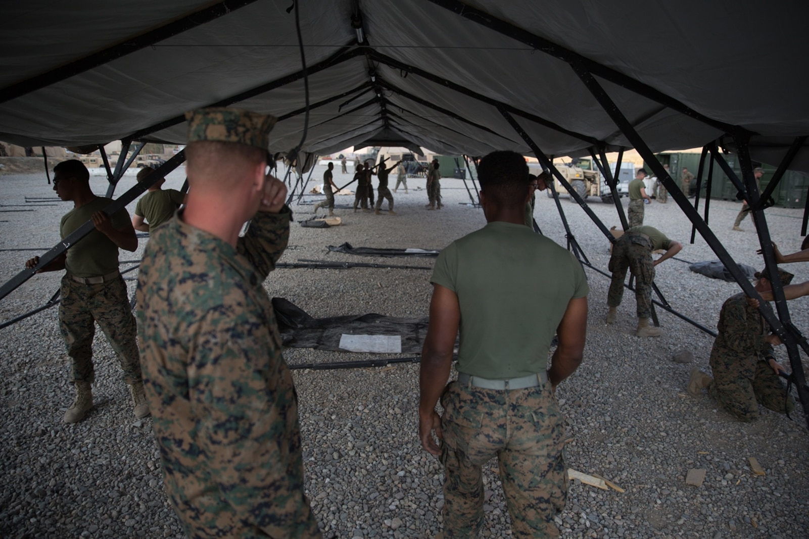 U.S. Marines with Combat Logistics Battalion 5 (CLB-5), Combat Logistics Regiment 1, 1st Marine Logistics Group, help form the foundation of an expeditionary mess hall on the Marine Corps Mountain Warfare Training Center in Bridgeport, Calif., June 14, 2017. CLB-5 supports the 2d Battalion, 8th Marine Regiment, 2d Marine Division, logistically by tackling the technical aspects of mountainous and cold weather operations by providing them chow, water, and fuel. (U.S. Marine Corps photo by Lance Cpl. Timothy Shoemaker)