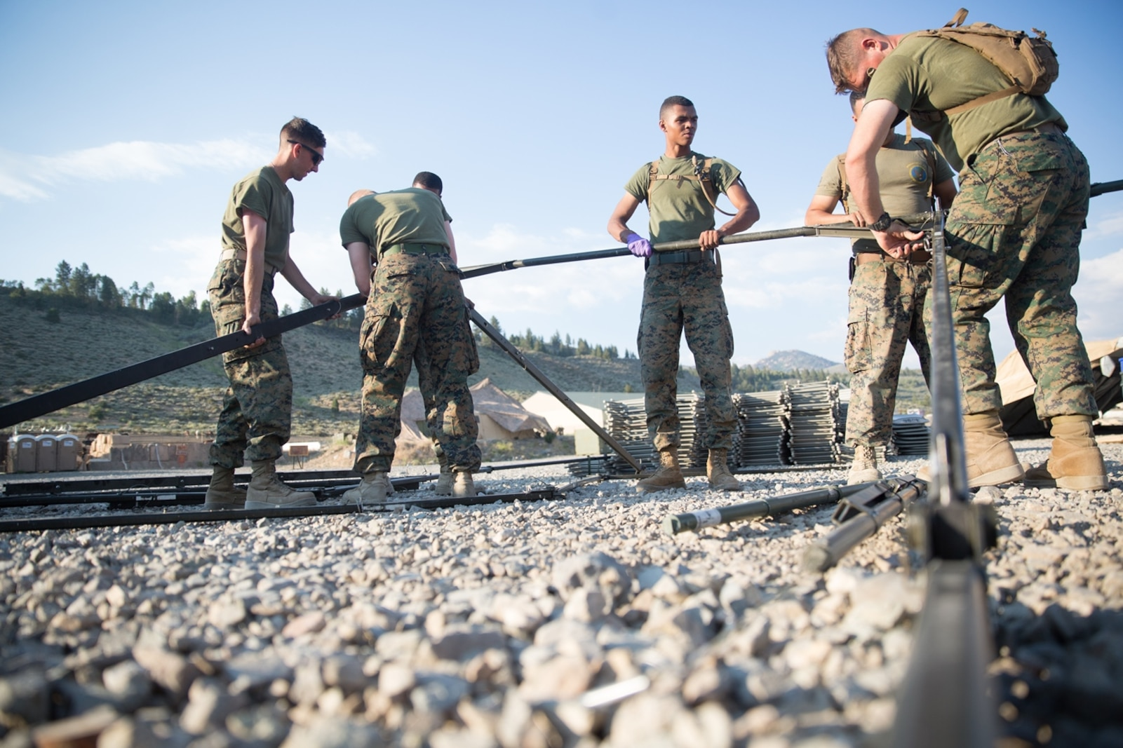 U.S. Marines with Combat Logistics Battalion 5 (CLB-5), Combat Logistics Regiment 1, 1st Marine Logistics Group, help form the foundation of an expeditionary mess hall tent on the Marine Corps Mountain Warfare Training Center Bridgeport, Calif., June 14, 2017. CLB-5 supports the 2d Battalion, 8th Marine Regiment, 2d Marine Division, logistically by tackling the technical aspects of mountainous and cold weather operations by providing them chow, water, and fuel. (U.S. Marine Corps photo by Lance Cpl. Timothy Shoemaker)