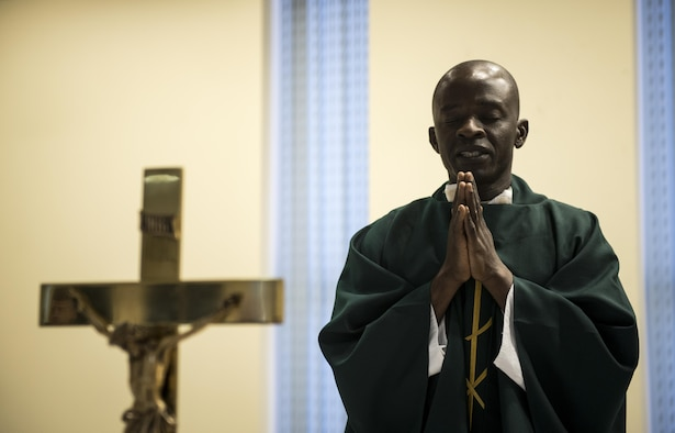 Chaplain (Capt.) John Appiah, 455th Air Expeditionary Wing, leads a prayer during a religious service at Hamid Karzai International Airport, Kabul, Afghanistan, July 23, 2017. Religious support teams from the 455th AEW provide spiritual support in seven locations in Afghanistan. (U.S. Air Force photo by Staff Sgt. Benjamin Gonsier)