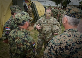 Army Lt. Gen. Ben Hodges, commanding general of U.S. Army Europe, speaks with Serbian medical professionals with the Balkan Medical Task Force during mass casualty medical training at Mihail Kogalniceanu Air Base, Romania, July 16, 2017. The training is part of exercise Saber Guardian 17, a U.S. Army Europe-led multinational exercise that spans across Bulgaria, Hungary and Romania with more than 25,000 service members from 22 allied and partner nations. Army photo by Sgt. Tyler Meister