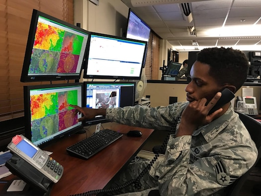 Senior Airman Quincy Jones, 15th Operational Weather Squadron weather forecaster, points to weather patterns on screen at Scott Air Force Base, Ill. (courtesy photo)