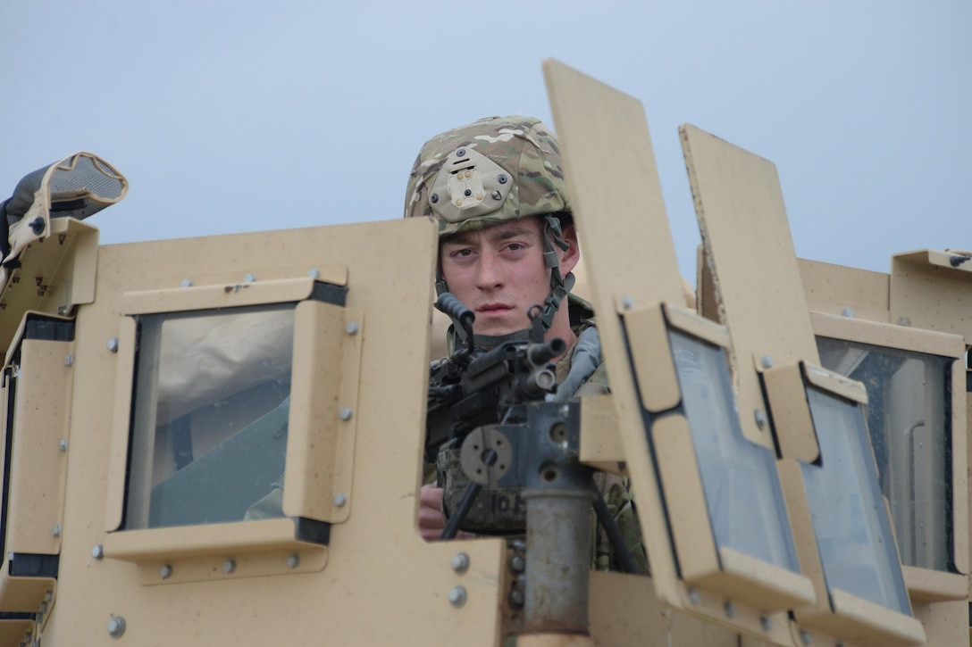U.S. Air Force Senior Airman Tanner Hart, of the 219th Security Forces Squadron, mans an M240 Squad Automatic Weapon (SAW) from a roof turret of a High Mobility Multipurpose Wheeled Vehicle (HMMWV), commonly known as a Humvee, during a training exercise at a launch facility in the Minot Air Force Base missile field complex, near Minot, N.D., June 15, 2017. He is a member of the North Dakota Air National Guard training and working seamlessly, side-by-side with U.S. Air Force active duty security forces members of the 91st Missile Wing as they maintain security standards in the missile fields. (U.S. Air National Guard Photo by Senior Master Sgt. David H. Lipp/Released)