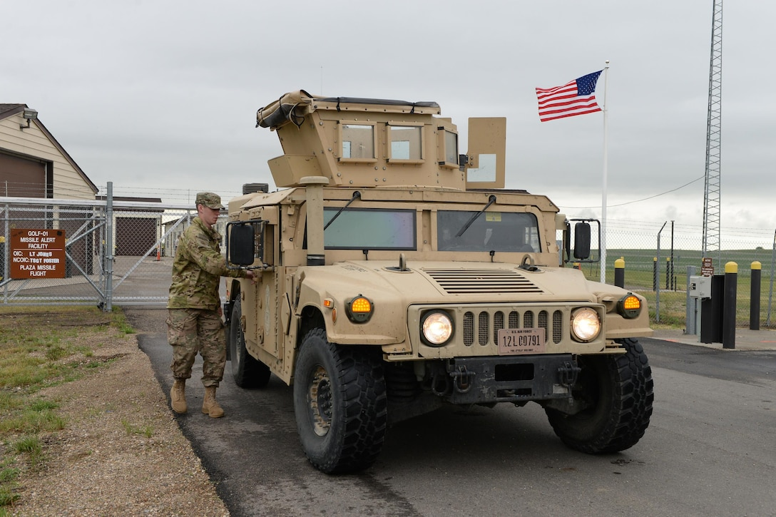 U.S. Air Force Senior Airman Tanner Hart, of the 219th Security Forces Squadron, opens the door to a High Mobility Multipurpose Wheeled Vehicle (HMMWV), commonly known as a Humvee, as he prepares to leave a missile alert facility in the Minot Air Force Base missile field complex, near Minot, N.D., June 15, 2017. He is a member of the North Dakota Air National Guard training and working seamlessly, side-by-side with U.S. Air Force active duty security forces members of the 91st Missile Wing as they maintain security standards in the missile fields. (U.S. Air National Guard Photo by Senior Master Sgt. David H. Lipp/Released)