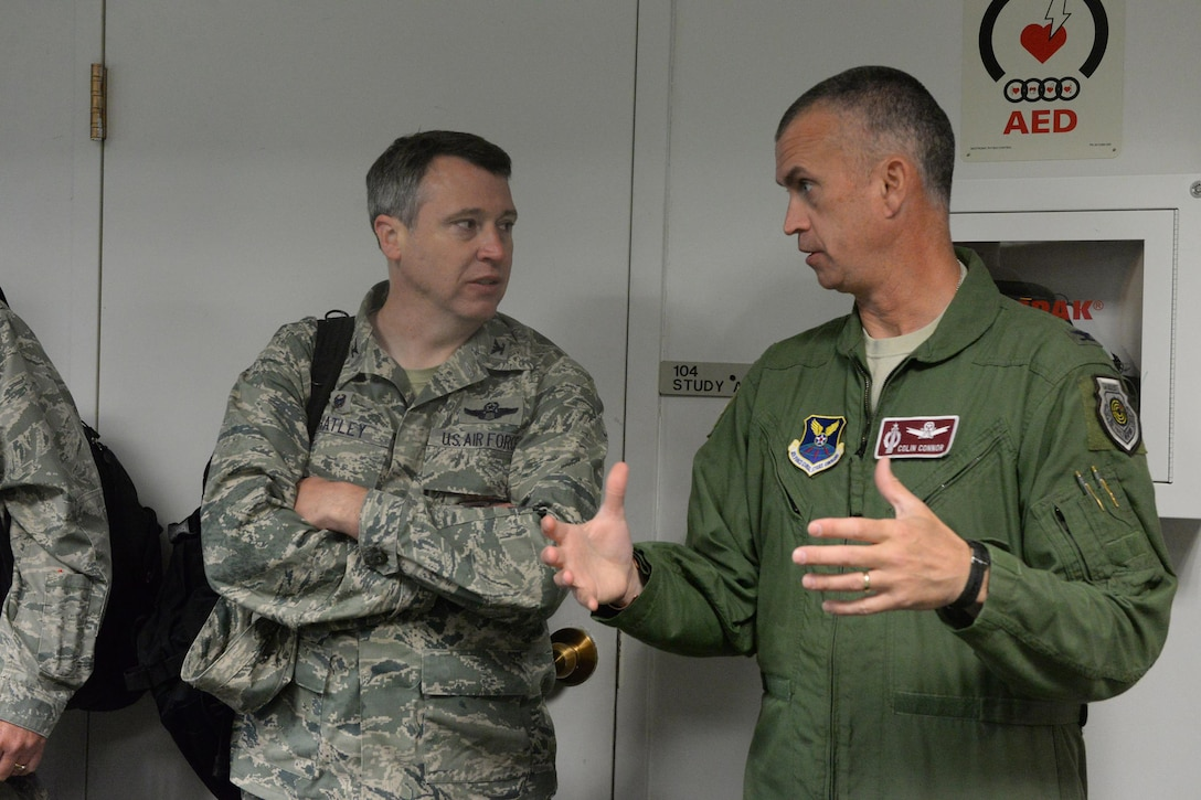 U.S. Air Force Col. Colin Connor, the 91st Missile Wing commander, right, discusses missile alert facility operations with Col. Britt Hatley, the 119th Wing commander, upon Hatley's arrival at a Minot Air Force Base, N.D., missile alert facility June 15, 2017. Hatley is visiting North Dakota Air National Guard unit members under his command who are working seamlessly, side-by-side with U.S. Air Force active duty security forces members of the 91st Missile Wing, under the command of Conner. (U.S. Air National Guard Photo by Senior Master Sgt. David H. Lipp/Released)