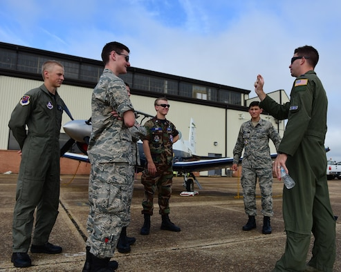 Capt. Whitt Hollis, 41st Flying Training Squadron Class Flight Commander, speaks to Civil Air Patrol cadets July 25, 2017, on Columbus Air Force Base, Mississippi. The cadets saw static displays of all three Columbus AFB aircraft and learned about the process of becoming an Air Force pilot. (U.S. Air Force photo by Elizabeth Owens)