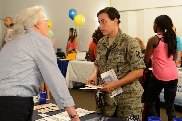 Military families get their questions answered directly from schools at the Back to School Night hosted by the 2nd Force Support Squadron at Barksdale Air Force Base, La., July 24, 2017. The event hosted multiple schools from the Bossier City and Caddo Parish school districts in order to provide families with all the tools and information they need to make a decision on where to send their children to school. (U.S. Air Force Photo/Airman 1st Class Sydney Bennett)
