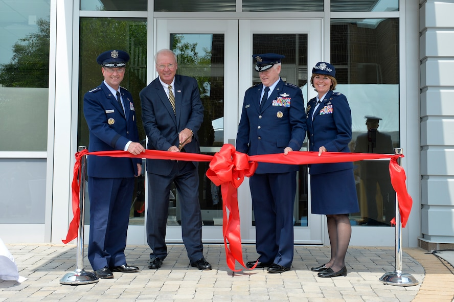 Gen. Joseph Lengyel, chief of the National Guard Bureau; retired Gen. Craig R. McKinley, national chair for the Employer Support of the Guard and Reserve for the Secretary of Defense; Lt. Gen. L. Scott Rice, director of the Air National Guard; and Col. Kerry Lovely, commander of the I.G. Brown Training and Education Center, cut the ribbon to Craig R. McKinley Hall, July 27, 2017, during a dedication ceremony on McGhee Tyson Air National Guard Base in East Tennessee. (U.S. Air National Guard photo by Master Sgt. Jerry Harlan)