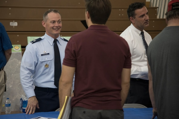 FOUNTAIN, Colo. – Lt. Col. Landon Phillips, 21st Civil Engineer Squadron commander, and Fred Brooks, 21st CES environmental chief, answer community members questions during an open house at Janitell Junior High School, July 25, 2017, Fountain, Colo. The open house was one of several community engagements between 21st Space Wing leadership, Air Force Civil Engineer Center and the Colorado Springs community on the release of the site inspection report on the perfluorooctane sulfonate and perfluorooctanoic acid contamination released that day. (U.S. Air Force photo by Staff Sgt. Tiffany Lundberg)