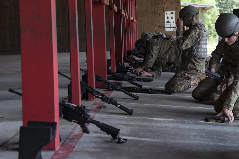 Airmen prepare to shoot at the Combat Arms Training and Maintenance range, July 25, 2017, at Moody Air Force Base, Ga. During CATM, Airmen must demonstrate quality safety standards while handling and shooting their weapons in order to qualify to deploy. (U.S. Air Force photo by Airman 1st Class Erick Requadt)