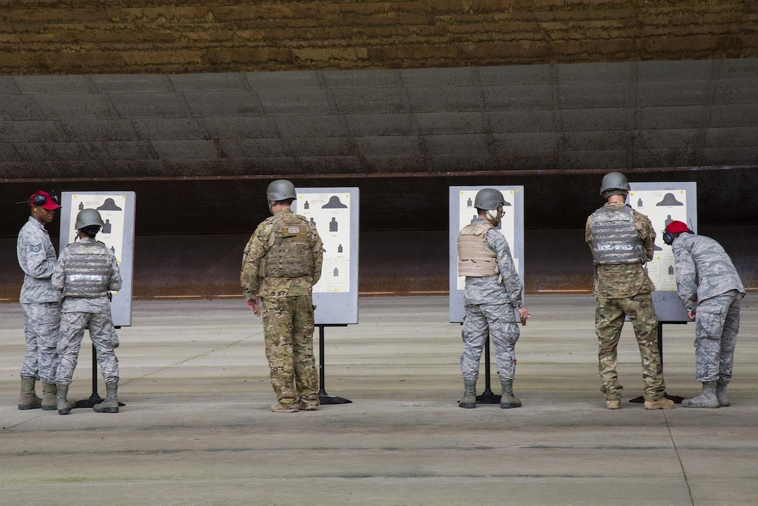 Airmen analyze their targets at the Combat Arms Training and Maintenance range, July 25, 2017, at Moody Air Force Base, Ga. During CATM, Airmen must demonstrate quality safety standards while handling and shooting their weapons in order to qualify to deploy. (U.S. Air Force photo by Airman 1st Class Erick Requadt)