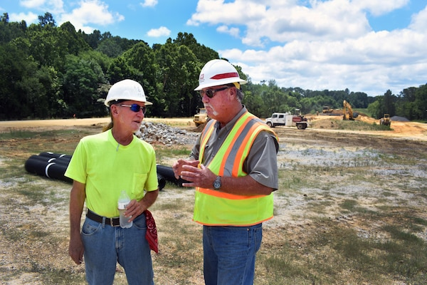 Ken Cooper, Mobile District site superintendent, left, gives an update on the Northport levee project to Mike Armstrong, a Mobile District construction representative. Mobile District is in the midst of relocating the Northport, Ala., levee, after a crack was discovered.