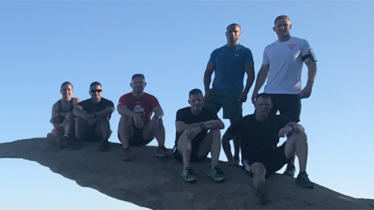 Force 12 Commanders seize the summit of Mt Woodson (a.k.a. Potato Chip Rock), during recent PT/PME event at District HQ, July 26, 2017.