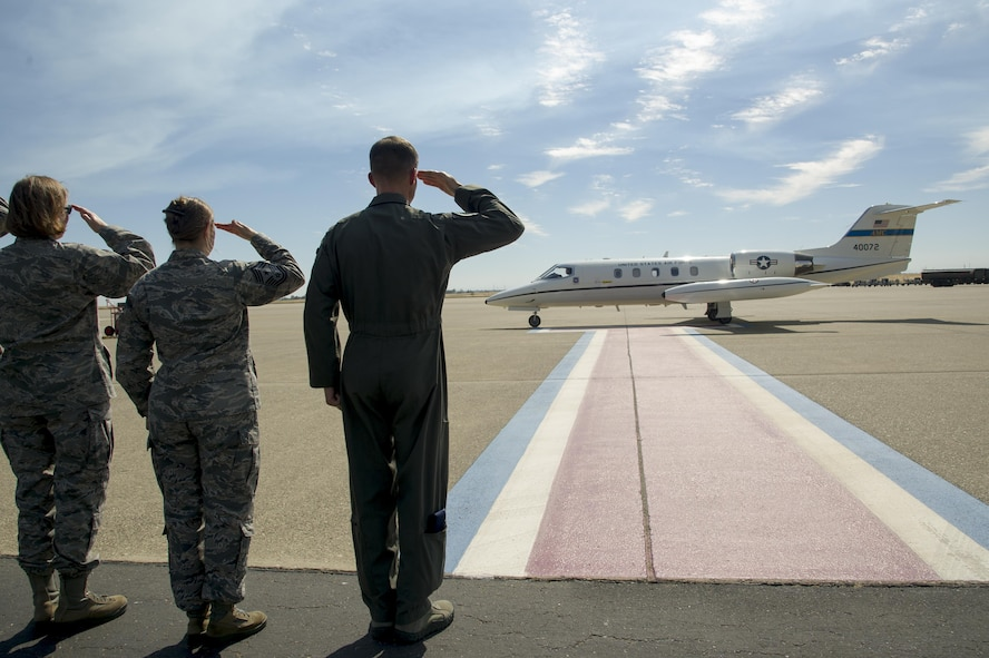 Beale Air Force Base senior leaders salute as the Air Force Reserve Command senior leaders arrive July 14, 2017, at Beale AFB, California. It was the first AFRC senior leader visit in seven years. (U.S. Air Force photo by Senior Airman Tara R. Abrahams)