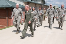 Lt. Gen. L. Scott Rice, Director of the Air National Guard is escorted by Col. Shaun Perkowski, 167th Airlift Wing commander, during a tour of the base, July 26. Rice and Chief Master Sgt. Ronald Anderson, ANG Command Chief, met with Airmen from each group at the Martinsburg, W.Va. air base. West Virginia National Guard Adjutant General, Maj. Gen. James A. Hoyer, Assistant Adjutant General for Air, Brig. Gen. Paige Hunter and State Command Chief, Chief Master Sgt. James Dixon joined the ANG leadership on the tour. Before visiting the 167AW, Rice and Anderson visited the National Boy Scouts Jamboree in Glen Jean, W.Va., and the 130th Airlift Wing in Charleston, W.Va. (U.S. Air National Guard photo by Senior Master Sgt. Emily Beightol-Deyerle)