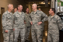 Air National Guard Command Chief, Chief Master Sgt. Ronald Anderson, second from right, talks with 167th Airlift Wing maintenance chiefs, Chief Master Sgt. Todd Kirkwood, Chief Master Sgt. Richard Long, and Chief Master Sgt. Keith Foreman during his visit to the Martinsburg, W.Va. air base, July 26. Lt. Gen. L. Scott Rice, Director of the Air National Guard and Anderson, toured the 167th Airlift Wing and met with Airmen. West Virginia National Guard Adjutant General, Maj. Gen. James A. Hoyer, Assistant Adjutant General for Air, Brig. Gen. Paige Hunter, and State Command Chief, Chief Master Sgt. James Dixon joined the ANG leadership on the tour of the Martinsburg air base. Before visiting the 167AW, Rice and Anderson visited the National Boy Scouts Jamboree in Glen Jean, W.Va., and the 130th Airlift Wing in Charleston, W.Va. (U.S. Air National Guard photo by Senior Master Sgt. Emily Beightol-Deyerle)