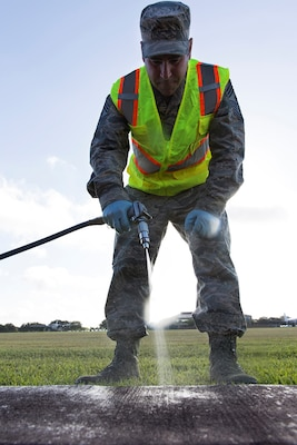 Chief Master Sgt. Kristopher K. Berg, 502nd Air Base Wing and Joint Base San Antonio command chief, sprays pesticides at JBSA-Lackland, Texas, July 20, 2017. Senior leadership from 502nd ABW and JBSA accompanied the 502nd Civil Engineer Squadron Pest Management pest control technicians as they completed work orders and took measures to keep the insect and animal population in check throughout the installation.