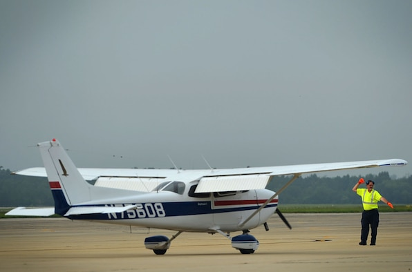 Tim Darrah, 20th Equipment Maintenance Squadron aircraft servicer, marshals a civilian Cessna 172, during a General Aviation Fly-in event at Shaw Air Force Base, S.C., July 28, 2017. The event gave the local aviation community an opportunity to land aircraft at Shaw and learn about the 20th Fighter Wing mission. (U.S. Air Force photo by Senior Airman Christopher Maldonado)