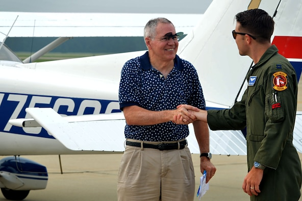 U.S. Air Force Capt. Kyle Bruton, 20th Fighter Wing flight safety chief, greets James Counts, Cessna 172 pilot, during a General Aviation Fly-in event at Shaw Air Force Base, S.C., July 28, 2017. Local aviators received the opportunity to talk to pilots and Airmen about current and future flying conditions. (U.S. Air Force photo by Senior Airman Christopher Maldonado)