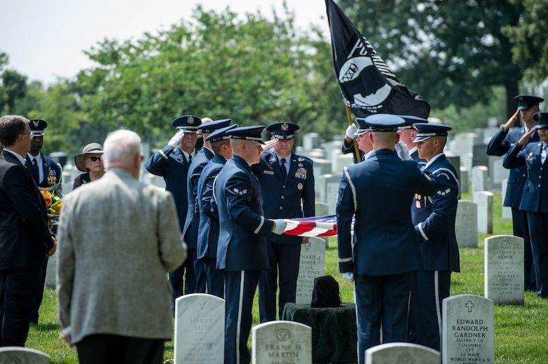 Air Force Ceremonial Guardsmen fire a volley during retired Air Force Col. Freeman Bruce Olmstead's funeral at Arlington National Cemetery, Arlington, Va., July 27, 2017. For his actions as a Prisoner of War, Olmstead received Silver Star, Distinguished Flying Cross and Purple Heart. (U.S. Photo/Andy Morataya)
