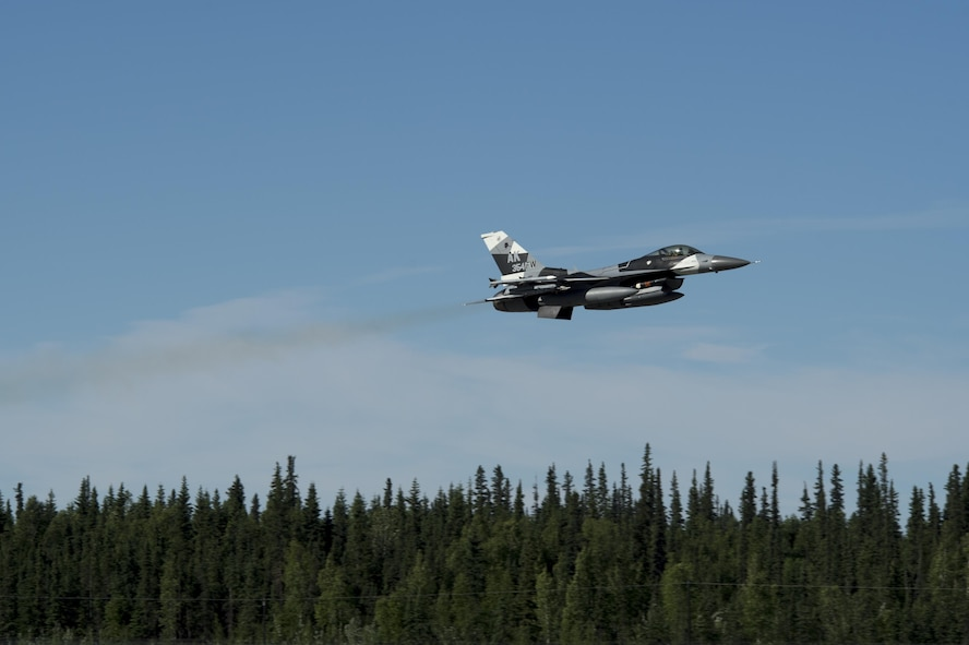 A U.S. Air Force F-16 Fighting Falcon aircraft takes off from the flight line during RED FLAG-Alaska 17-2 June 13, 2017, at Eielson Air Base, Alaska. RED FLAG-Alaska provides an optimal training environment in the Indo-Asia Pacific Region and focuses on improving ground, space, and cyberspace combat readiness and interoperabillity for U.S. and international forces.  (U.S. Air Force photo by Airman 1st Class Haley D. Phillips)