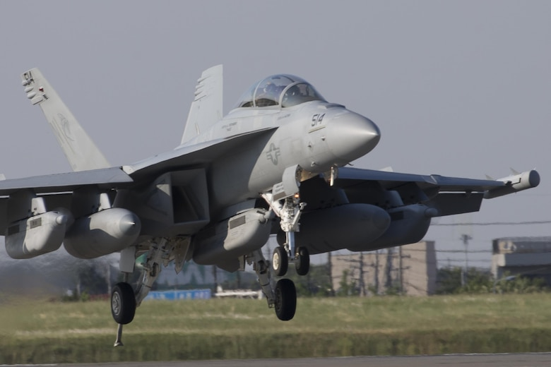 A Navy EA-18G Growler, assigned to the Electronic Attack Squadron (VAQ) 138, deploys a J-Hook to engage the aircraft arresting barrier system at Yokota Air Base, Japan, June 3, 2016. The 374th Civil Engineer Squadron power productions shop and fire department and 374th Operations Support Squadron airfield management flight are responsible for testing the system annually. (U.S. Air Force photo by Yasuo Osakabe/Released)