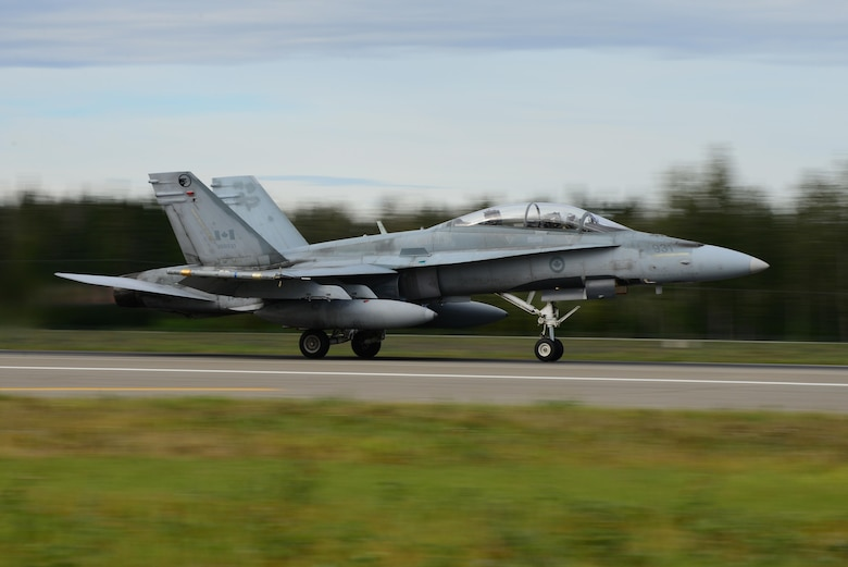 A Royal Canadian Air Force CF-18 Hornet aircraft assigned to the 409th Tactical Fighter Squadron, Canadian Forces Base Cold Lake, Alberta, takes off from the Eielson Air Force Base, Alaska, runway Aug. 15, 2016, during RED FLAG-Alaska 16-3. The aircraft will participate in a morning sortie over the Joint Pacific Alaska Range Complex airspace, which spans more than 67,000 square miles and provides a realistic training environment that allows commanders to train for full spectrum engagements, ranging from individual skills to complex, large-scale engagements. (U.S. Air Force photo by Airman 1st Class Cassandra Whitman)