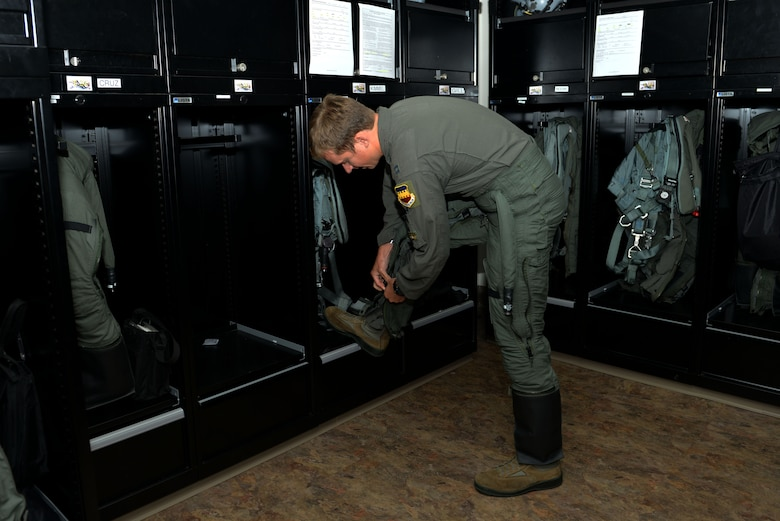 U.S. Air Force Capt. Matthew Kimmel, 79th Fighter Squadron (FS) pilot and U.S. Thunderbirds pilot-select, puts on his G-suit in the 79th FS locker room at Shaw Air Force Base, S.C., July 19, 2017. Kimmel will be leaving the squadron in October to join the demonstration team as pilot No. 6. (U.S. Air Force photo by Airman 1st Class Destinee Sweeney)